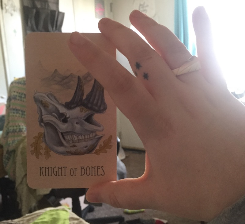 The Knight of Bones card from The Wooden Tarot deck by Skullgarden