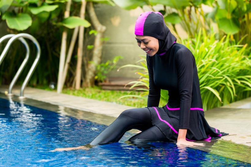 Some French towns have banned the burkini bathing suit. Image: Shutterstock.