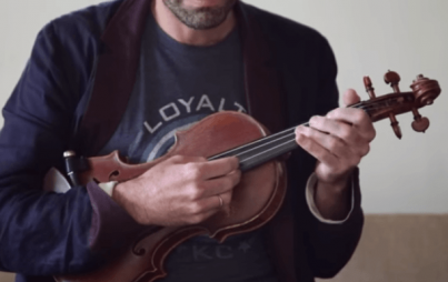Screenshot of Andrew Bird's perfect, perfect fingers strumming away at his perfect, perfect cover.