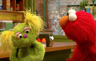 Karli and Elmo (via YouTube)